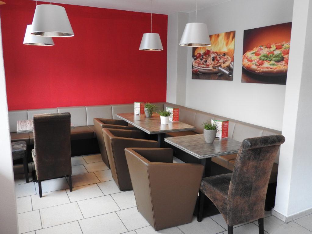 Genießen Sie in gemütlicher Atmosphäre und lassen Sie sich in unserer Pizzeria verwöhnen